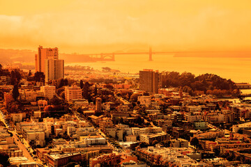 foggy orange sky of San Francisco skyline. California fires in United States of America. Composition about wildfires and climate change concepts.