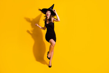 Full length body size view of her she nice attractive pretty slender thin cheerful cheery lady dancing having fun festal occasion event isolated bright vivid shine vibrant yellow color background