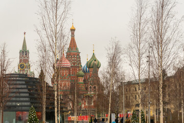 MOSCOW,RUSSIA - December 18, 2019: festive christmas decoration of Zaryadye park. View to St Basils and Spasskaya tower.