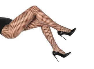 pretty female legs in fishnet stockings and black high heels