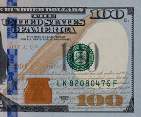 fragment of 100 dollar bill