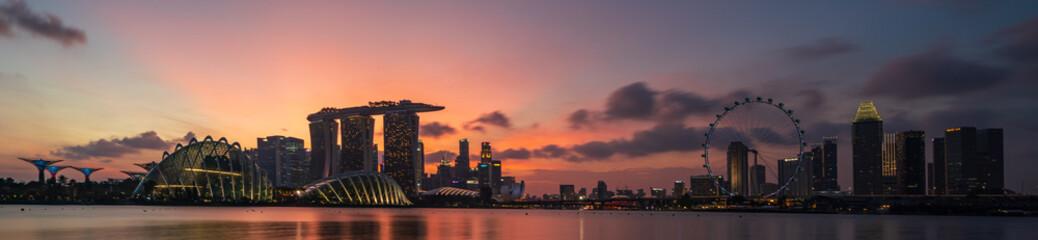 Wide panorama of Cityscape of Singapore Marina bay area at dusk.