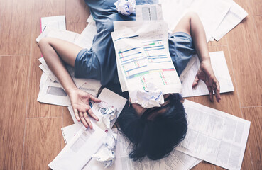 Woman with debts and bills.