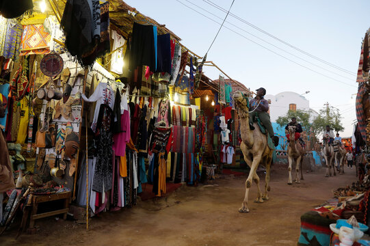 Nubian men ride camels at the Nubian village Gharb Soheil, on the west bank of the Nile river in Aswan