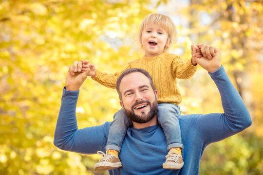 Happy family having fun outdoor in autumn park