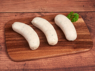 Bavarian white sausages (weisswurst) on a wooden board