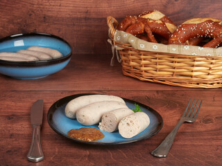 Bavarian white sausages (weisswurst) with sweet mustard and pretzels