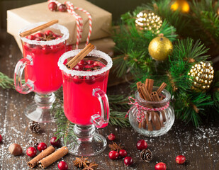 Festive Cranberry drink on Christmas background