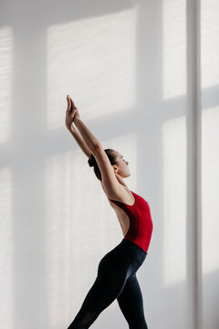 Young beautiful yoga woman is posing in studio.
