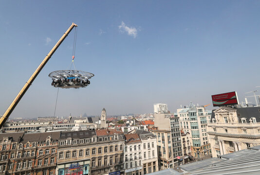 """People sit at a table during """"Dinner in the Sky 2.0 New Generation"""" in Brussels"""