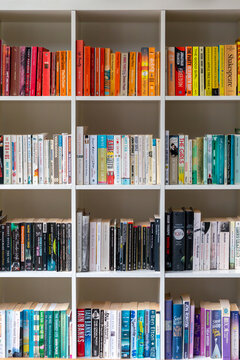 White wooden bookcase filled with books in a UK home