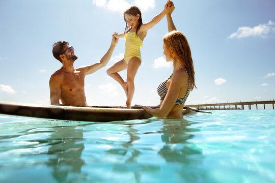 Family enjoying tropical beach holiday