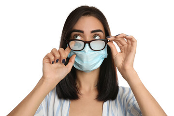 Wall Murals Coffee bar Young woman wiping foggy glasses caused by wearing disposable mask on white background. Protective measure during coronavirus pandemic