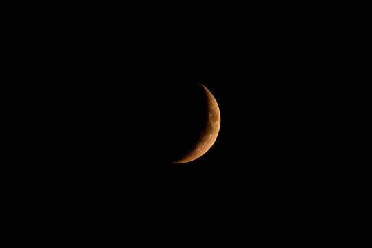 Sliver of crescent moon in the night