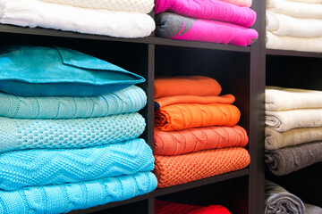 Row of colorful clothes on shelf