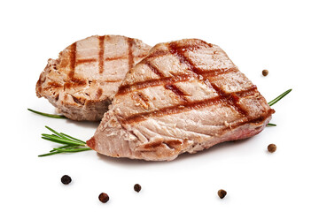 Two grilled tuna steak with rosemary and spices isolated on white