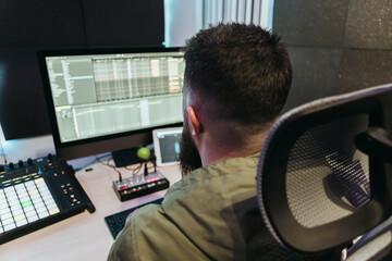 Dj producing music in his studio