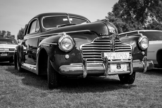"""DIEDERSDORF, GERMANY - AUGUST 30, 2020: The full-size car Buick Super coupe, 1940. Black and white. The exhibition of """"US Car Classics""""."""