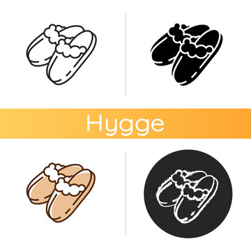 Sheepskin shearling slippers icon. Comfortable home shoes. Hygge style. Comfy knit bootie slippers. Coziness atmosphere. Linear black and RGB color styles. Isolated vector illustrations