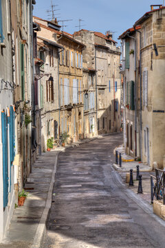 Street with historical houses in Arles, France