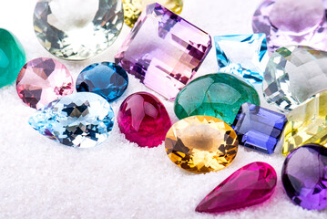 Group of gemstones on white sand.