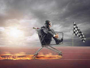 Businessman runs fast driving a cart on fire during a competition