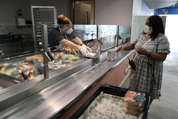 Employees prepare food for people in quarantine at Union Rescue Mission homeless shelter, amid the coronavirus disease (COVID-19) outbreak, in Los Angeles