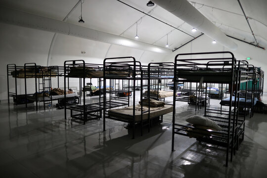 People sleep in socially-distanced beds in a sprung structure at Union Rescue Mission homeless shelter, amid the coronavirus disease (COVID-19) outbreak, in Los Angeles