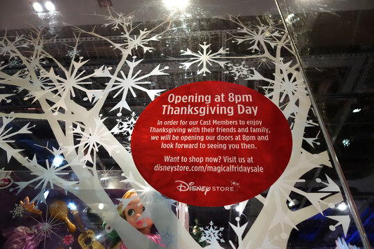 'Opening at 8pm Thanksgiving Day' for Grey Thursday sign at the Disney store