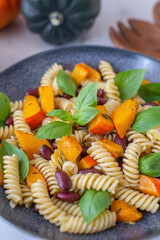 vegan autumn pasta with pumpkin and black beans