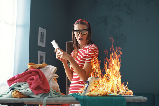 Distracted careless housewife burning clothes with the iron