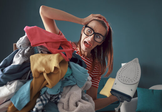 Frustrated housewife ironing clothes
