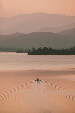 Rowboat on tranquil lake at sunset, Whiskeytown Lake, Redding, California, USA