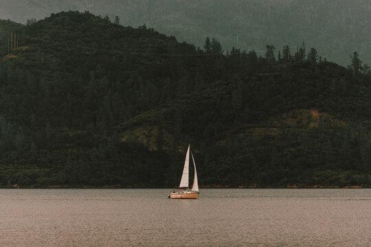 Sailboat on tranquil Whiskeytown Lake, Redding, Shasta County, California, USA