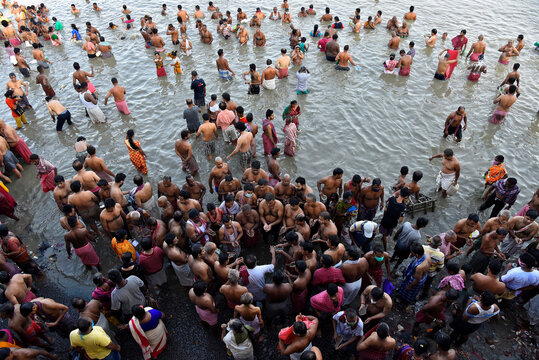 Devotees gather to perform Tarpana on the banks of the Ganges river to honour the souls of their departed ancestors during the auspicious day of Mahalaya in Kolkata