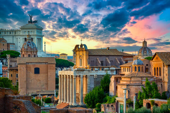 Aerial panoramic cityscape view of the Roman Forum and Roman Altar of the Fatherland in Rome, Italy. World famous landmarks in Italy during summer sunset
