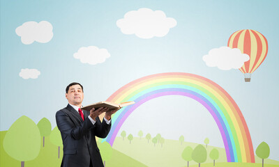 Happy businessman holding open book