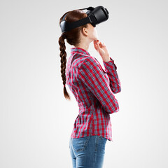 Girl in mask experiencing virtual reality as new entertainment device