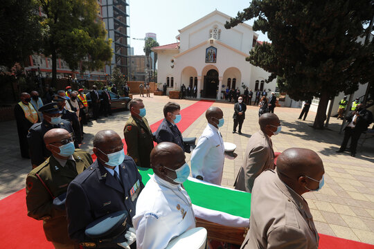 Pallbearers carry the coffin during the funeral of human rights lawyer George Bizos in Johannesburg