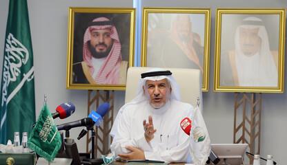 Abdullah bin Abdulaziz Al Rabeeah signs an agreement with the World Food Programme for Yemen, in Riyadh
