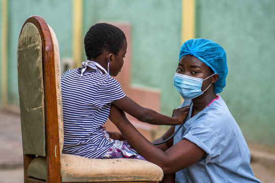 Closeup shot of a boy and a doctor wearing sanitary mask
