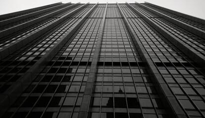 Fototapeta Street Level View Looking Up at a Minimalist, Clean Lined Skyscraper in Manhattan, New York