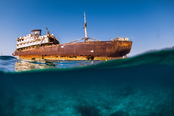Split shot with wreckship in blue ocean. Arrecife, Lanzarote
