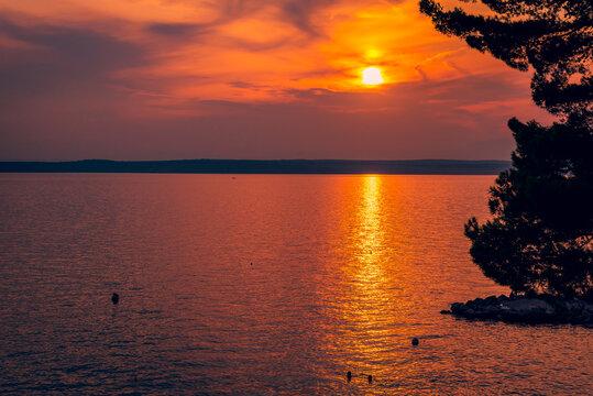 Sunset on the adriatic sea in the summer in Crikvenica, Croatia