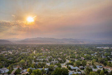 wildfire smoke from Cameron Peak Fire (September 2020) over Fort Collins and Front Range of Rocky Mountains in northern Colorado,  aerial view