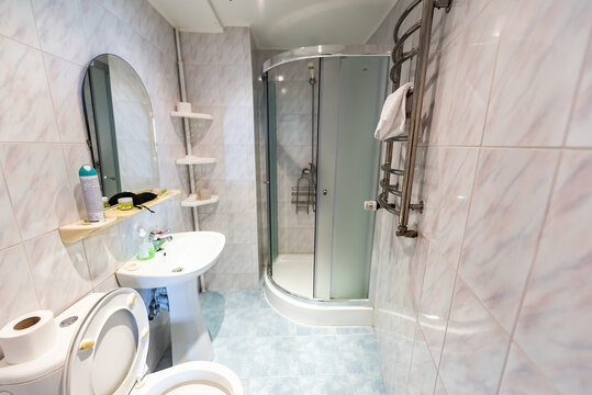 New clean staging model home, house, hotel hostel or apartment guesthouse shower bath bathroom European old-fashioned old interior, nobody, toilet paper in Ukraine