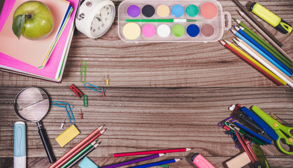 back to school concept. stationery items on wooden desk