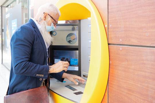 Senior man with ATM