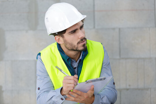 construction manager with clipboard outdoors