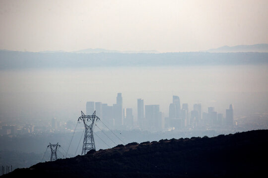 The downtown Los Angeles skyline is blanketed by the smoke from a wildfire